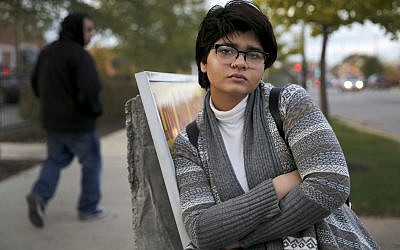 In this Friday, Nov. 3, 2017, photo, Chicago high school senior Hira Zeeshan poses for a portrait in the West Ridge neighborhood of Chicago. (AP Photo/Charles Rex Arbogast)