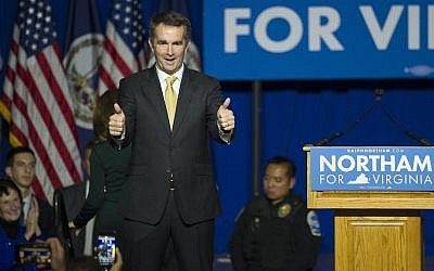 Virginia Gov.-elect Ralph Northam walks onstage to celebrate his election at the Northam For Governor election night party at George Mason University in Fairfax, Virginia, November 7, 2017. (AP Photo/Cliff Owen)