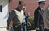 In this October 31, 2017 file photo, US Marine Gunnery Sgt. Joseph A. Felix, his wife, and his lawyers exit a courtroom after testimony at Camp Lejeune, North Carolina. (Rory Laverty/The Washington Post via AP)