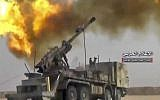 A frame grab from video provided by the government-controlled Syrian Central Military Media, shows firing on militants' positions on the Iraq-Syria border, November 8, 2017. (Syrian Central Military Media, via AP)