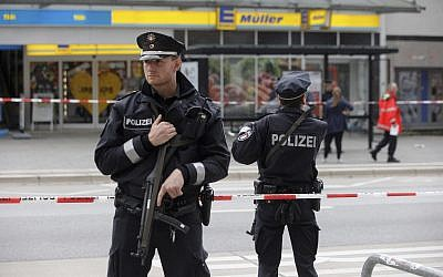 Illustrative: In this July 28, 2017 file photo police officers secure the area after a knife attack at a supermarket in Hamburg, Germany. (Markus Scholz/dpa via AP)