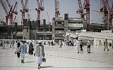 In this file photo from Sept. 15, 2015, Muslim pilgrims walk outside the Grand Mosque in the holy city of Mecca, Saudi Arabia. (AP Photo/Mosa'ab Elshamy, File)