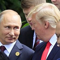 Russian President Vladimir Putin, left, and US President Donald Trump talk as they arrive for the family photo session during the Asia-Pacific Economic Cooperation (APEC) Summit in Danang, Vietnam, Saturday, Nov. 11, 2017. (AP Photo/Hau Dinh)