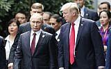 US President Donald Trump, right, and Russia's President Vladimir Putin talk during the family photo session at the APEC Summit in Danang, Vietnam Saturday, November 11, 2017. (Jorge Silva/Pool Photo via AP)