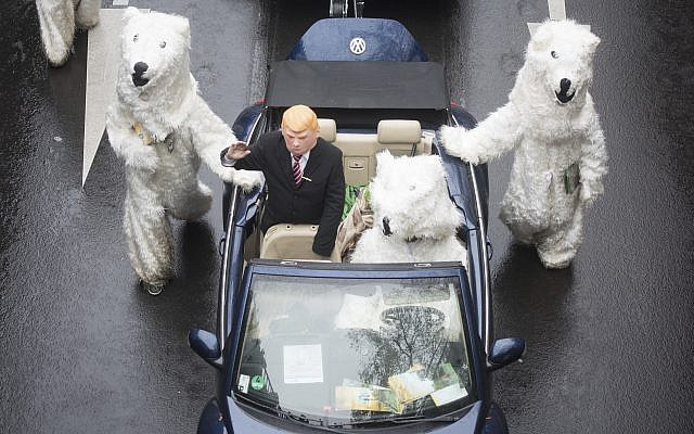 Demonstrators costumed as US President Donald Trump and polar bears protest against the climate change during climate conference COP in Bonn, western Germany, Saturday, Nov. 11, 2017. (Bernd Thissen/dpa via AP)