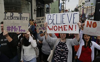 Illustrative: Participants march against sexual assault and harassment at the #MeToo March in the Hollywood section of Los Angeles on November 12, 2017.  (AP Photo/Damian Dovarganes)