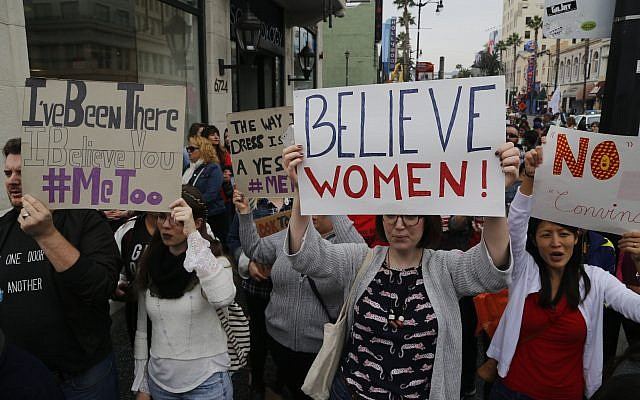 Participants march against sexual assault and harassment at the #MeToo March in the Hollywood section of Los Angeles on November 12, 2017.  (AP Photo/Damian Dovarganes)