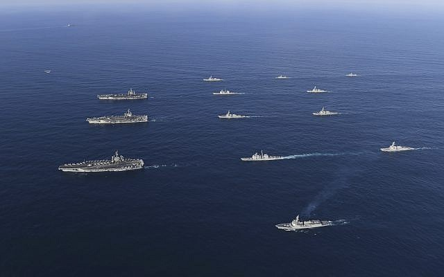 In this photo provided November 12, 2017, three US aircraft carriers USS Nimitz, left top, USS Ronald Reagan, left center, and USS Theodore Roosevelt, left bottom, participate with other US and South Korean navy ships during the joint naval exercises between the United States and South Korea in waters off South Korea's eastern coast, November 12, 2017. (South Korea Defense Ministry via AP)