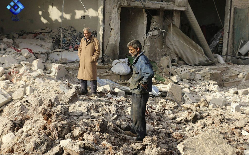 People inspecting damage from airstrikes hit in Atareb town, in the western Aleppo countryside, of Syria, November 13, 2017. (Thiqa News via AP)