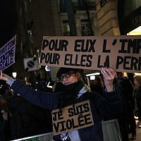 "Activist holding a banner reading: ""For him impunity, for her a life sentence"" during a protest in Paris, November 14, 2017.  (AP Photo/Christophe Ena, File)"