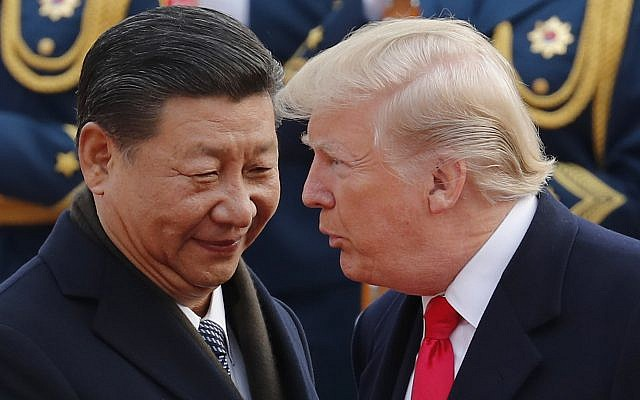 US President Donald Trump, right, chats with Chinese President Xi Jinping during a welcome ceremony at the Great Hall of the People in Beijing, November 9, 2017. (AP/Andy Wong)