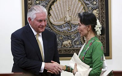 Myanmar's leader Aung San Suu Kyi, right, shakes hands with visiting US Secretary of State Rex Tillerson after their press conference at the Foreign Ministry office in Naypyitaw, Myanmar, Wednesday, Nov. 15, 2017. (AP Photo/Aung Shine Oo)