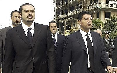 In this Feb. 19, 2005 file photo, Bahaa Hariri, right, and Saad Hariri, sons of slain Lebanese former Prime Minister Rafik Hariri, visit the scene where their father was assassinated in Beirut, Lebanon (AP photo, File)