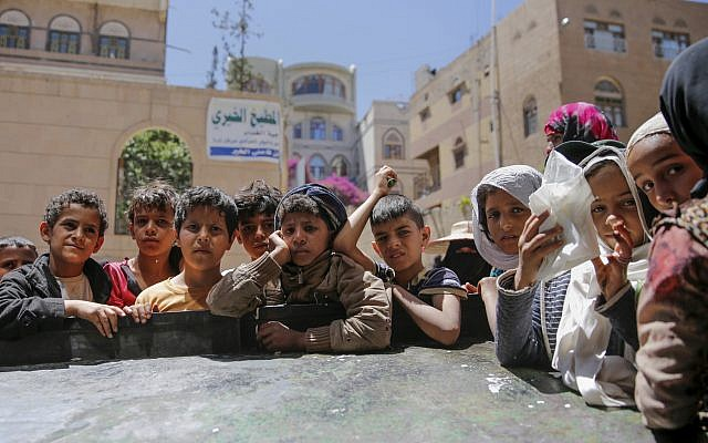 Yemeni children wait to receive food rations provided by a local charity, in Sanaa, Yemen, April, 13, 2017. (AP Photo/Hani Mohammed, File)