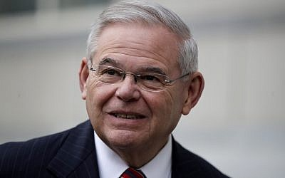 U.S. Sen. Bob Menendez answers a question from a reporter before entering the Martin Luther King Jr. Federal Courthouse for his federal corruption trial, Thursday, Nov. 16, 2017, in Newark, N.J. Jury deliberations continued on Thursday morning. (AP Photo/Julio Cortez)