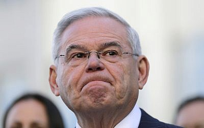 Democratic Sen. Bob Menendez becomes emotional as he speaks to reporters in front of the courthouse in Newark, N.J., November 16, 2017. (AP Photo/Seth Wenig)