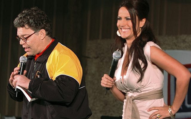 In this image provided by the US Army, then-comedian Al Franken and sports commentator Leeann Tweeden perform a comic skit for service members during the USO Sergeant Major of the Army's 2006 Hope and Freedom Tour in Camp Arifjan, Kuwait, on Dec. 15, 2006. (Staff Sgt. Patrick N. Moes/U.S. Army via AP)