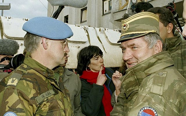 Former Bosnian Serb commander Ratko Mladic, right, leaves the UN headquarters at Sarajevo airport after talks with the UN General, Sir Michael Rose and Bosnian Commander Rasim Delic, April 9, 1994. (AP/Enric Marti)