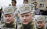 Bosnian Serb protesters holding posters depicting former Bosnian Serb army chief Ratko Mladic, during a protest in Mladic's hometown of Kalinovik, Bosnia-Herzegovina, May 29, 2011. (AP/Amel Emric)
