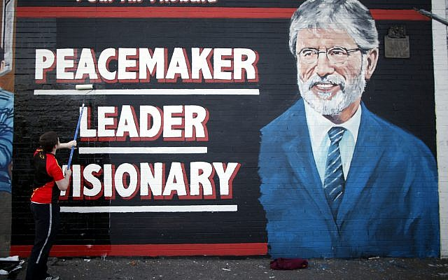 A newly painted mural of Gerry Adams on the Falls Road, West Belfast, Northern Ireland, May, 2 2014. (AP Photo/Peter Morrison, file)