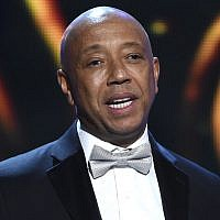 In this Feb. 6, 2015, file photo, hip-hop mogul Russell Simmons presents the Vanguard Award on stage at the 46th NAACP Image Awards in Pasadena, California (Chris Pizzello/Invision/AP, File)