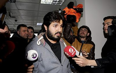 Turkish-Iranian businessman Reza Zarrab, who in 2017 was facing charges in the US for evading sanctions on Iran, is surrounded by the media members as he arrives at a courthouse in Istanbul, in a separate case against him, December. 17, 2013. (Depo Photos via AP/File)
