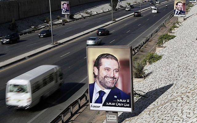 """Posters showing Lebanese Prime Minister Saad Hariri with Arabic that reads, """"No happiness without you Saad,"""" hang along the airport highway, in Beirut, Lebanon, Monday, Nov. 20, 2017. (AP Photo/Hussein Malla)"""