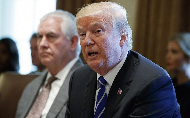 Secretary of State Rex Tillerson (l) listens as US President Donald Trump announces that the United States will designate North Korea a state sponsor of terrorism during a cabinet meeting at the White House, November 20, 2017, in Washington. (AP Photo/Evan Vucci)