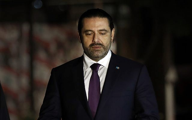 Lebanese Prime Minister Saad Hariri prays over his father's grave upon his arrival in Beirut, Lebanon, November 21, 2017. (AP Photo/Hussein Malla)
