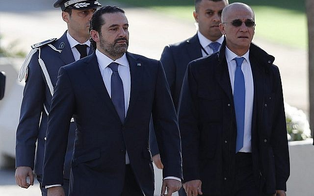 Lebanese Prime Minister Saad Hariri, left, arrives to attend a military parade to mark the 74th anniversary of Lebanon's independence from France in downtown Beirut, Lebanon, Wednesday, Nov. 22, 2017 (AP Photo/Hussein Malla)