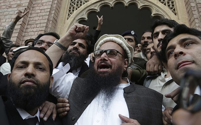 Hafiz Saeed, head of the Pakistani religious party, Jamaat-ud-Dawa, gestures outside a court in Lahore, Pakistan, November 22, 2017. (AP Photo/K.M. Chaudary)
