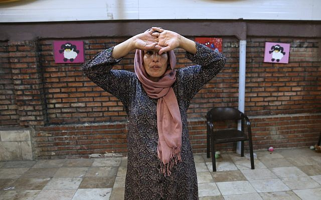 In this Wednesday, Sept. 27, 2017 photo, Mahboobeh Zeinali, who is HIV-positive, attends an acting class at Reviving Values aid group institute in Tehran, Iran. (AP Photo/Vahid Salemi)