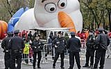 "Police officers stand near the site where a large balloon of the character Olaf from ""Frozen"" is being inflated for the Thanksgiving Day parade in New York, Wednesday, November 22, 2017. (AP Photo/Seth Wenig)"