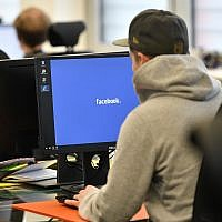 Employees of the Competence Call Center (CCC) work for the Facebook Community Operations Team in Essen, Germany, November 23, 2017. (AP Photo/Martin Meissner)