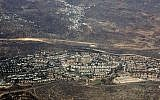 This September 20, 2010, aerial file photo, taken through the window of an airplane shows the West Bank settlement of Ariel. (AP Photo/Ariel Schalit, File)