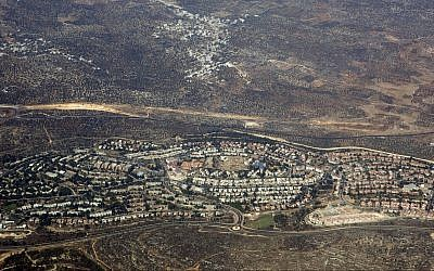 This Sept. 20, 2010, aerial file photo, taken through the window of an airplane shows the West Bank settlement of Ariel. (AP Photo/Ariel Schalit, File)