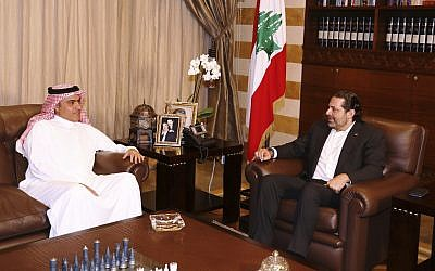 Lebanese Prime Minister Saad Hariri, right, meets with Saudi Minister for Gulf Affairs Thamer al-Sabhan, left, in Beirut, Lebanon, August 26, 2017. (Dalati Nohra via AP)