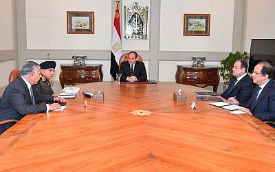 This photo released by Egypt's Presidency shows Abdel-Fattah El-Sissi, center, meeting with officials in Cairo after militants attacked a crowded mosque during Friday prayers in the Sinai Peninsula. (Egyptian Presidency via AP)