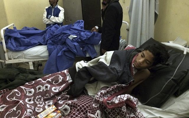 Abdallah Abdel Nasser, 14, receives medical treatment at Suez Canal University hospital in Ismailia, Egypt, Friday, Nov. 24, 2017, after he was in injured during a terror attack on a mosque in the deadliest ever attack by Islamic extremists in Egypt. (AP Photo/Amr Nabil)