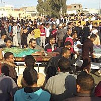 Injured people are evacuated from the scene of a terrorist attack on a mosque in Bir al-Abd in the northern Sinai Peninsula of Egypt on Friday, Nov. 24, 2017. (AP Photo)