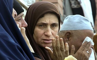 Relatives of worshipers grieve outside the Suez Canal University hospital in Ismailia, Egypt, Saturday, Nov. 25, 2017, a day after an attack on a mosque, the deadliest ever attack by Islamic terrorists in Egypt. (AP Photo/Amr Nabil)