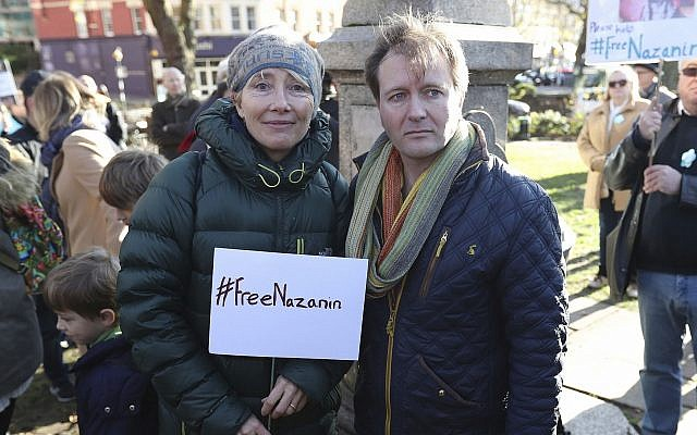 Richard Ratcliffe, the husband of Nazanin Zaghari-Ratcliffe who is detained in Iran, is joined by Oscar winning actress Emma Thompson in Hampstead, north London before setting out on a march calling for her release from prison, Nov.ember25, 2017.   (Jonathan Brady/PA via AP)