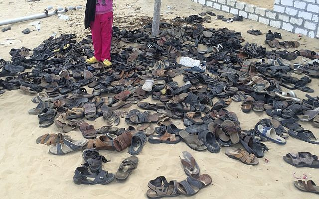 Discarded shoes of victims remain outside Al-Rawda Mosque in Bir al-Abd northern Sinai, Egypt. a day after attackers killed hundreds of worshippers, on Saturday, Nov. 25, 2017. .(AP Photo)