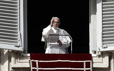 Pope Francis delivers a blessing during the Angelus noon prayer in St. Peter's Square at the Vatican, November 26, 2017. (AP Photo/Gregorio Borgia)