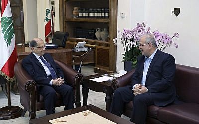 In this photo released by the Lebanese Government, Lebanese President Michel Aoun, left, meets with the head of Hezbollah's parliamentary bloc Mohammed Raad, at the Presidential Palace in Baabda, east of Beirut, Lebanon, November 27, 2017. (Dalati Nohra/Lebanese Government via AP)