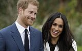 Britain's Prince Harry and his fiancee Meghan Markle pose for photographers during a photocall in the grounds of Kensington Palace in London, Monday Nov. 27, 2017. (AP Photo/Matt Dunham)