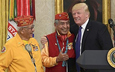 US President Donald Trump, right, meets with Navajo Code Talkers Peter MacDonald, center, and Thomas Begay, left, in the Oval Office of the White House, on November 27, 2017. (AP Photo/Susan Walsh)