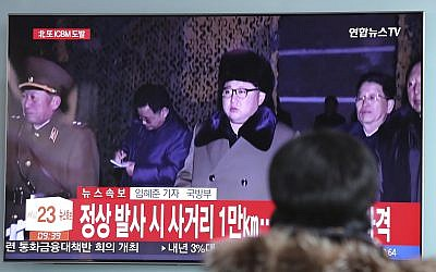 A woman watches a TV screen showing a local news program reporting about North Korea's missile launch with a file footage of North Korean leader Kim Jong Un, at the Seoul Railway Station in Seoul, South Korea, Wednesday, Nov. 29, 2017. (AP/Lee Jin-man)