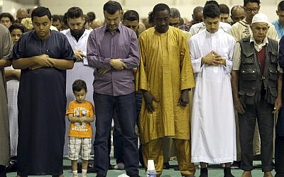 In this September 12, 2016 photo, Muslims offer Eid al-Adha prayers in a convention center in Marseille, southern France. (AP/Claude Paris)