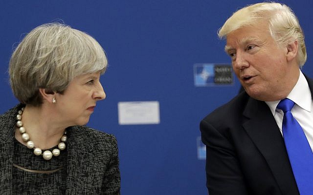US President Donald Trump (right), speaks to British Prime Minister Theresa May at the NATO headquarters in Brussels, May 25, 2017. (AP/Matt Dunham, Pool)